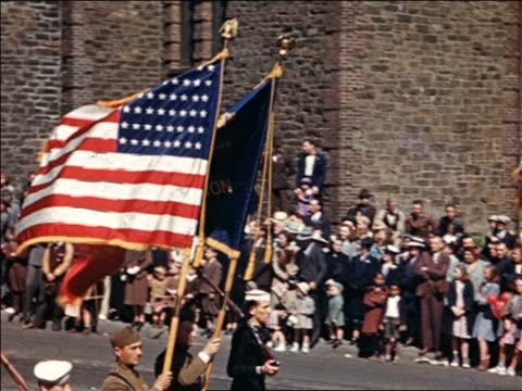 vídeos y material grabado en eventos de stock de 1940 pan soldiers carrying us and other flag in parade / home movie - 1940