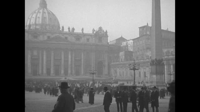 pan st. peter's square with crowd from colonnade, to obelisk to basilica, cars pass through, buildings in bg / note: exact year not known;... - 1920 stock videos & royalty-free footage