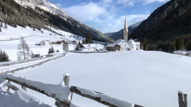 pan: st. sigismund im sellrain, tyrol, austria, in winter - innsbruck stock videos and b-roll footage