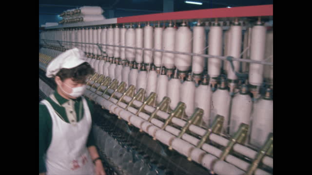 pan textile factory interior with one woman worker - taipei stock videos & royalty-free footage
