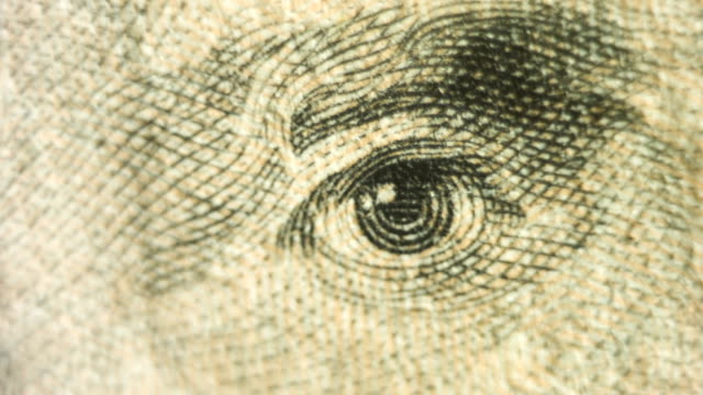 pan to a close up of andrew jackson's eyes on the $20 bill. - twenty us dollar note stock videos & royalty-free footage