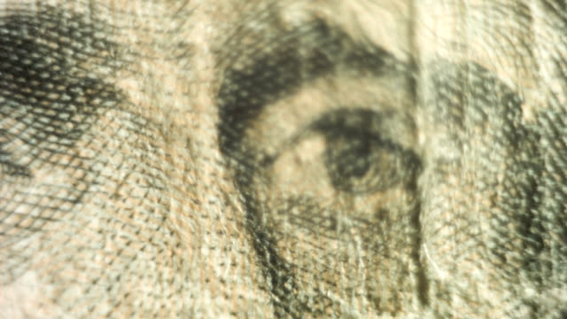Pan to a close up of Andrew Jackson's eyes on the twenty dollar bill