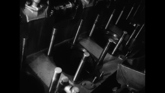stockvideo's en b-roll-footage met pan to ships in harbor / vs hatch door opens inside submarine to see men overhauling diesel engine / open hatches showing man at far side of corridor... - hatch