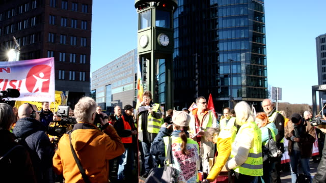 pan to the left a participant speaks at the rally supporters of the new leftwing stand up movement gather at a demonstration at potsdamer platz on... - social movement stock videos & royalty-free footage