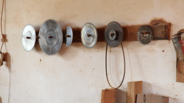 a pan to the left showing saw blades in different sizes hanging on the wall of a wood workshop and in the former jesuit reduction in concepción the... - jesuit stock videos and b-roll footage