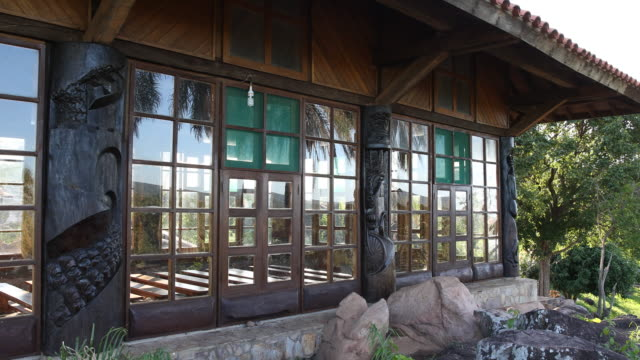 stockvideo's en b-roll-footage met pan to the left, showing the window front of the san rafael chapel in surucusí, a small village in el puente community in the guarayos region. the... - puente