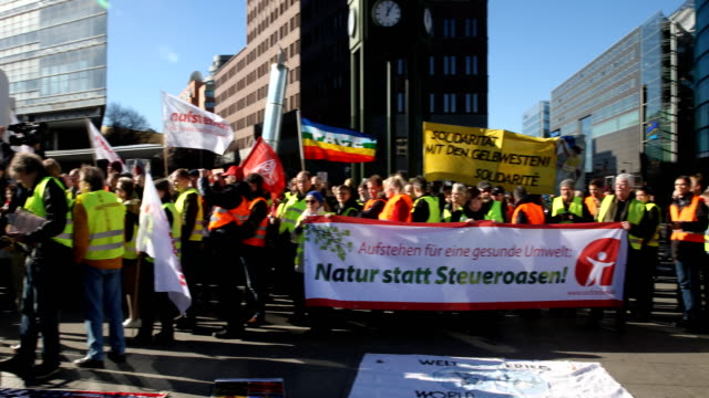 """pan to the right, a participant speaks at the rally. supporters of the new left-wing """"stand up"""" movement gather at a demonstration at potsdamer platz... - participant stock videos & royalty-free footage"""