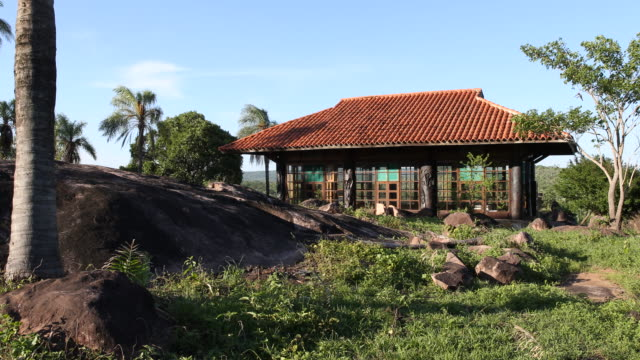 pan to the right, showing an exterior view with surrounding landscape of the san rafael chapel in surucusí, a small village in el puente community in... - puente点の映像素材/bロール