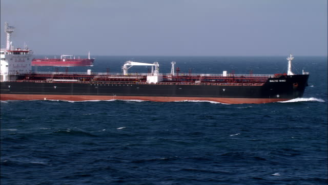 ws pan two oil tankers on english channel/ france - english channel stock videos and b-roll footage
