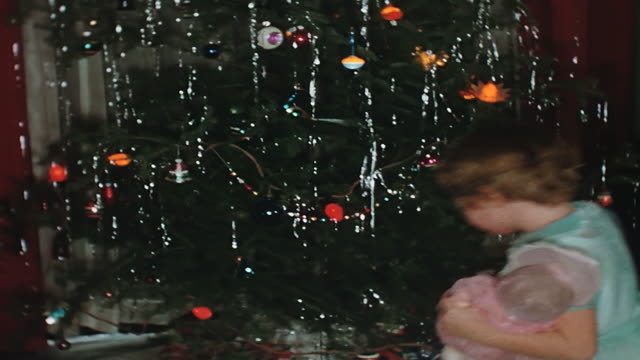 pan up a 1950's christmas tree. - home movie stock videos & royalty-free footage