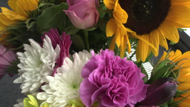 pan up a bouquet of brightly coloured flowers. - bouquet stock videos & royalty-free footage