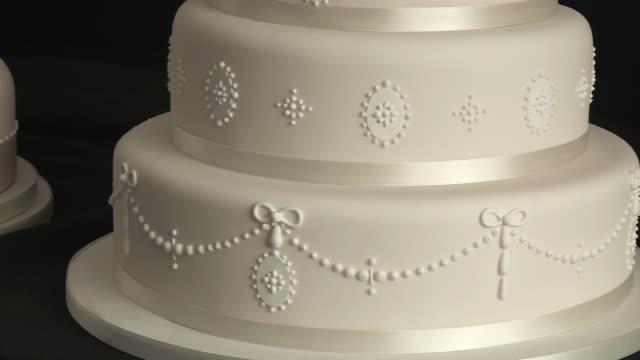 Pan up a tiered wedding cake.