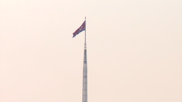 Pan up and down a huge flagpole in the North Korean town of Gijungdong near the demilitarized zone.