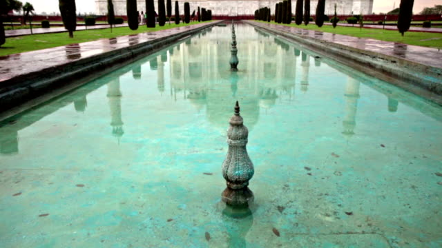 pan up and down shot of taj mahal and reflection in water. - taj mahal stock videos and b-roll footage