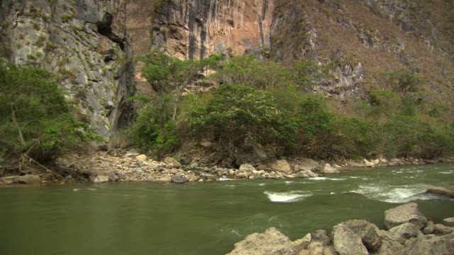 """pan up from green river rapids to cliff with dark cave, utcubamba river [rio utcubamba], peru [perãº]"" - river green stock videos & royalty-free footage"