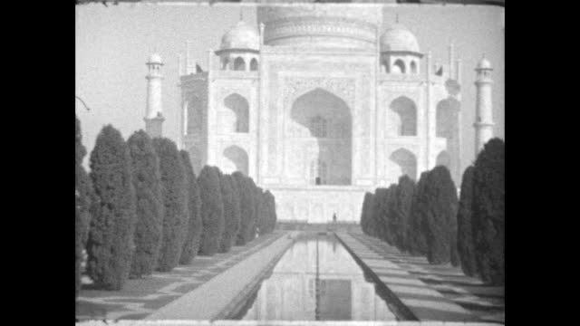 pan up from reflecting pool of taj mahal - agra stock videos and b-roll footage