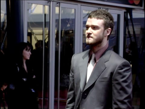 pan up justin timberlake on red carpet at brit awards london; 17 february 2004 - fame stock videos & royalty-free footage