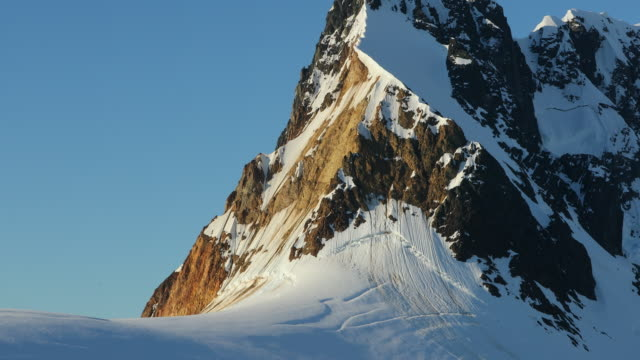 pan up mountain on antarctic peninsula - antarctic peninsula stock videos & royalty-free footage