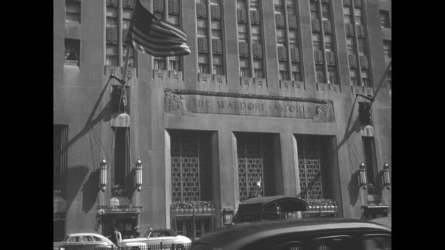 Pan up of facade of the Waldorf Astoria Hotel / Note exact year not known