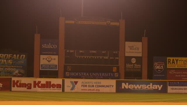pan up onto the long island ducks' scoreboard at bethpage ballpark, ny - scoreboard stock videos & royalty-free footage