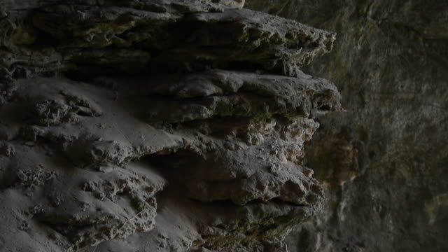 Pan up rock formations in Gorham's Cave at the base of the Rock of Gibraltar.
