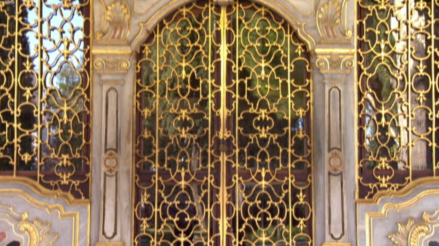 pan up the beautifully decorated front doors of the topkapi palace - ornate stock videos and b-roll footage