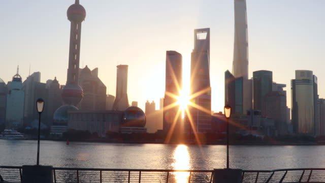 pan up, the bund and pudong skyline at sunrise - the bund stock videos & royalty-free footage