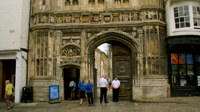 pan up the exterior of the beautifully decorated christ church gateway, canterbury. - canterbury cathedral stock videos & royalty-free footage