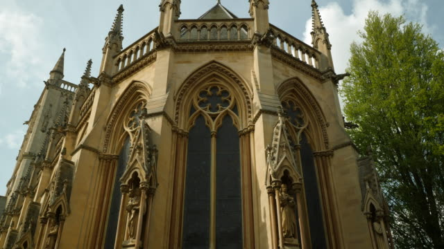 pan up the exterior of the chapel at st john's college, cambridge. - cambridge england stock videos and b-roll footage