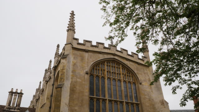 pan up the exterior of trinity college chapel, cambridge. - cambridge university stock videos and b-roll footage