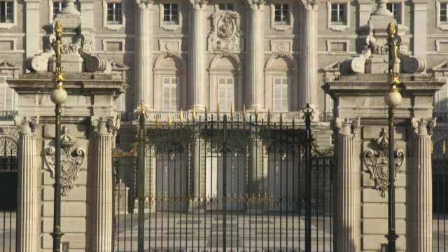 Pan up the front gates of the Royal Palace of Madrid, Spain.