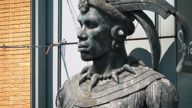 Pan up the Shaka Zulu statue in Camden Market, London