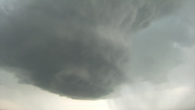 Pan up the updraft of a rotating severe thunderstorm. Supercell storm, LP Supercell base and updraft, stack of plates strom, twisting barber pole.