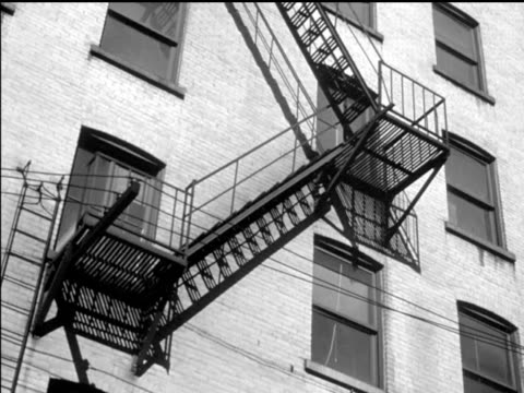 / pan up view of fire escapes on eightstory apartment building apartment building fire escape on january 01 1948 in ottawa - fire escape stock videos & royalty-free footage