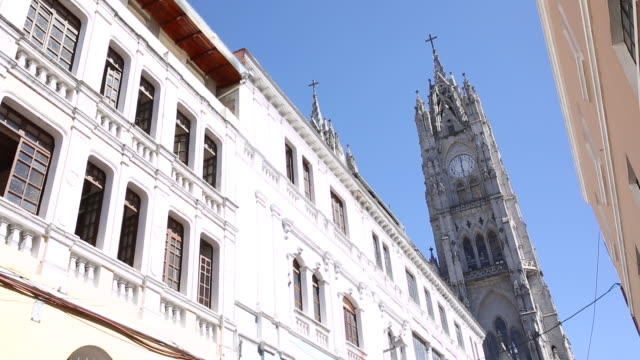 Pan upwards past colonial buildings to cathedral spires