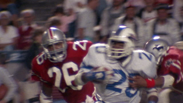 1985 MS pan Victor Jackson of the Orlando Renegades catching ball, running, and being tackled in game against Tampa Bay Bandits/ Tampa, Florida
