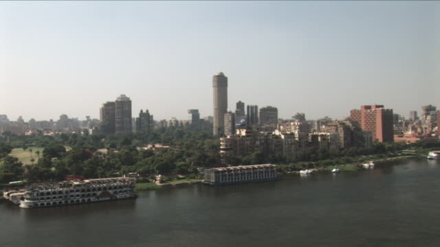 AERIAL WS Pan view of city, Nile river and bridge / Cairo, Egypt