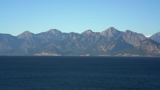 pan view of taurus mountain in antalya - mediterranean turkey stock videos and b-roll footage