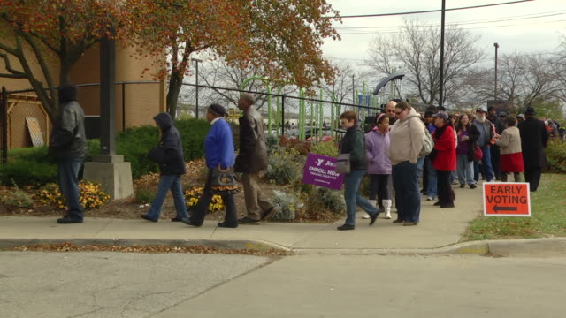 ms pan zi voters waiting in line to cast their ballots at early voting location two days before presidential election / toledo, ohio, united states - 投票点の映像素材/bロール