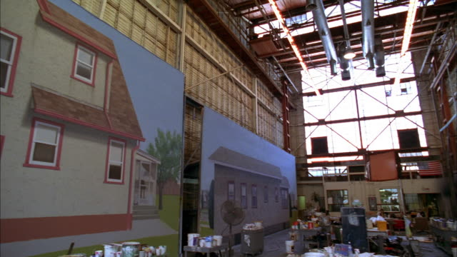 pan warehouse studio for scenic film art w/painted house backdrop / warner brothers studios - burbank stock-videos und b-roll-filmmaterial