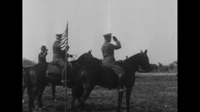 vs pan water towers and barracks in france / us general john pershing rides on horseback with other military officers pershing salutes / pan pershing... - storage tank stock videos and b-roll footage