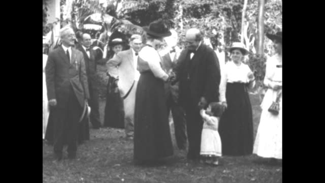 pan william jennings bryan and crowd of people standing around on lawn of his home in coconut grove fl with bryan holding hand of small child and... - william jennings bryan stock videos & royalty-free footage