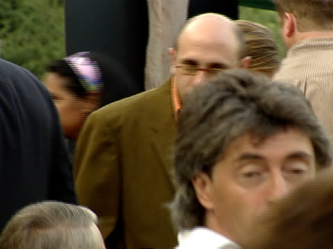 pan with willie garson as he walks through crowd at hollywood bowl - ウィリー ガーソン点の映像素材/bロール