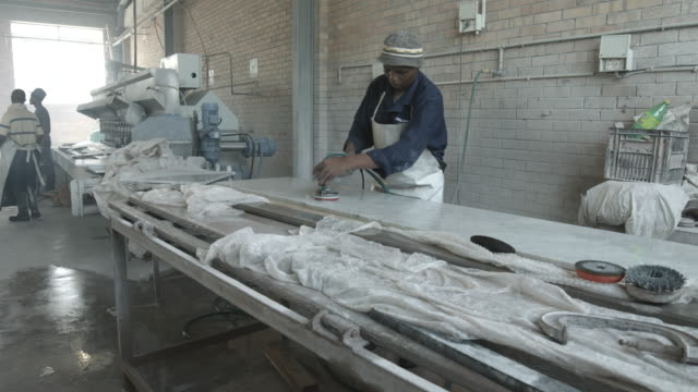 ws pan_factory worker polishing marble slab - sander stock videos and b-roll footage