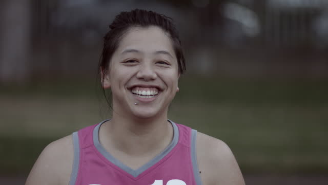 CU PAN_Portrait of female basket player laughing to camera