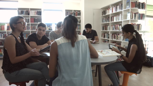 ws pan_students working together in high school library - e learning stock videos and b-roll footage