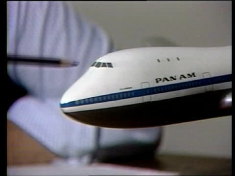 safety record; itn england: int cms boeing spokesman intvw sof : - well the potential -- cms model of pan am boeing 747 as pencil indicates nose -... - spokesman stock videos & royalty-free footage