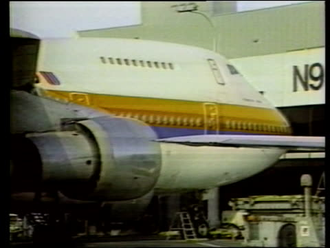 safety record; itn lib england: lap: ext side boeing 747 zoom in nose of plane - zoom in点の映像素材/bロール