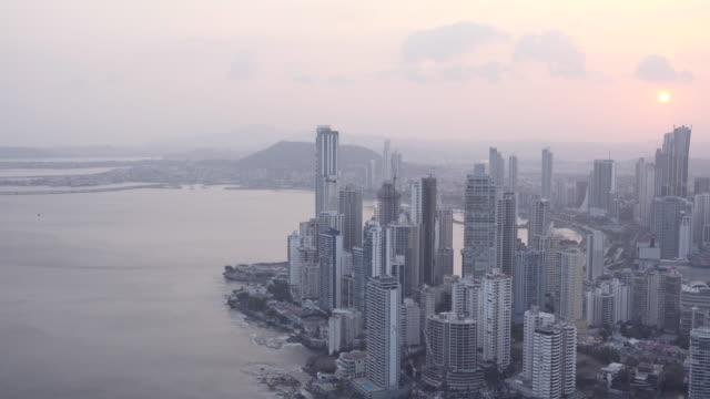 Panama city skyline at sunset. Lookout from a vantage point.