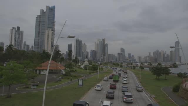 panama city traffic and skyline, wide shot - panama city panama stock videos & royalty-free footage
